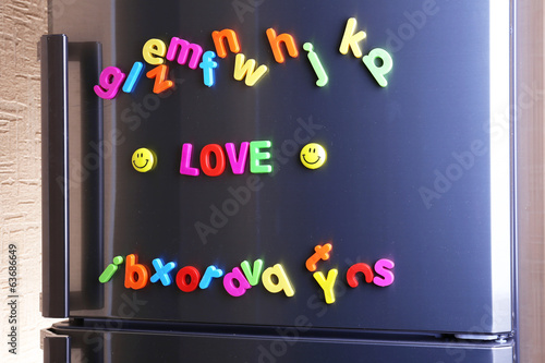 Word Love spelled out using colorful magnetic letters