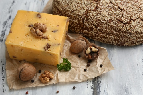 Tasty Italian cheese and bread on wooden table