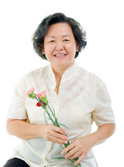 Asian senior woman holding carnation flower