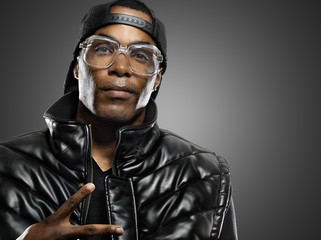 funky african american man with glasses on studio background.