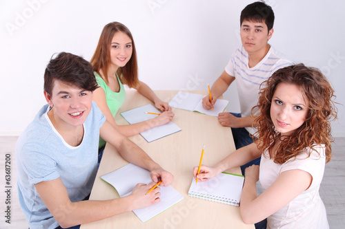 Group of young students sitting in room
