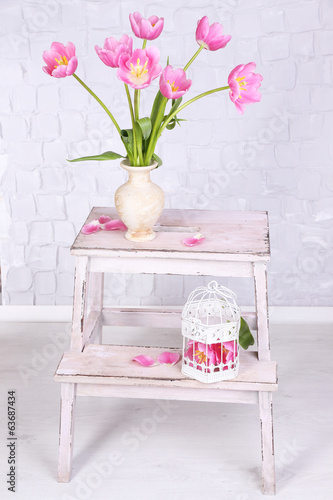 Beautiful pink tulips on grey wall background