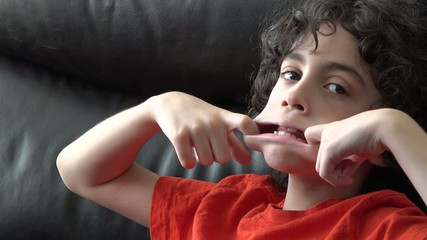 Hispanic boy gesturing and doing facial expressions
