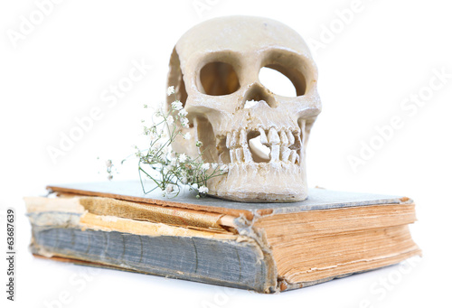 Skull on old book isolated on white