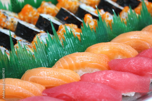 Close up the chopsticks with japanese sushi.