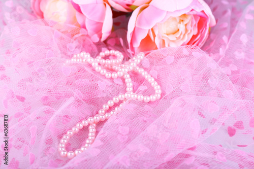 Beautiful pearls on pink cloth