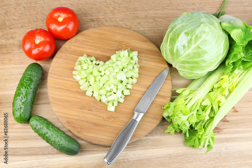 Heart shape of chopped celery  and fresh vegetables,