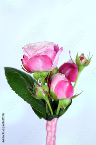 Beautiful boutonniere on bright background