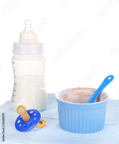 Baby food and milk isolated on white