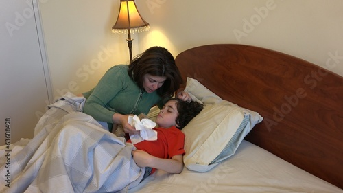 Single mother or parent looking after her sick son
