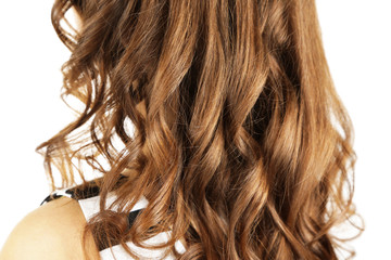Woman with curly long hair isolated on white