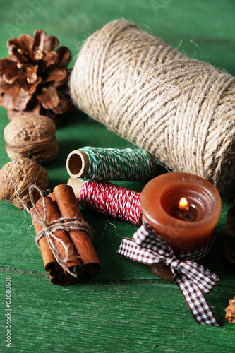 Composition with natural bump, candle, thread, cinnamon sticks