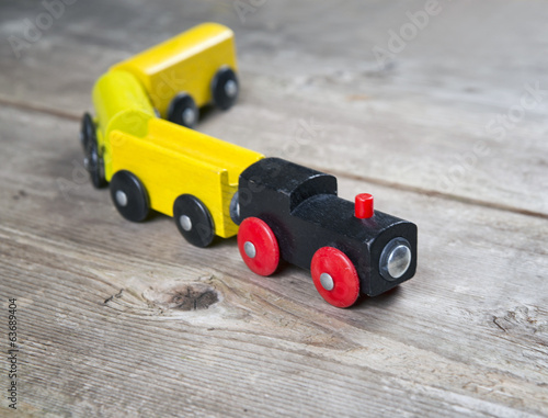 Toy train in wooden background