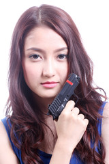 Asian woman with the gun on her hand
