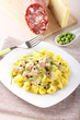 Tortellini with cream, peas and ham