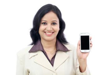 Young business woman showing mobile phone against white
