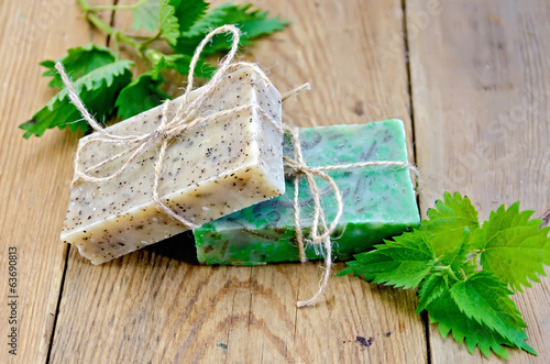 Soap homemade with nettle on the board