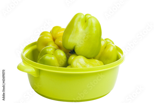 Group of green peppers in a light green bowl