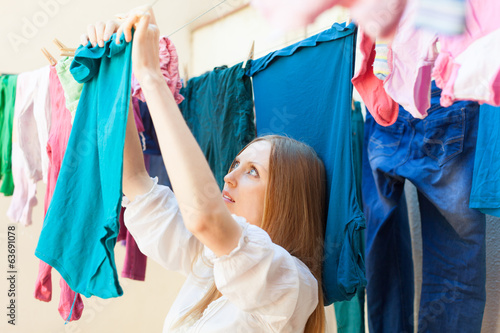 housewife drying clothes on clothes-line