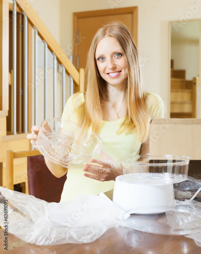 cheerful woman unpacking new  steamer