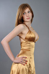beautiful girl in a gold dress
