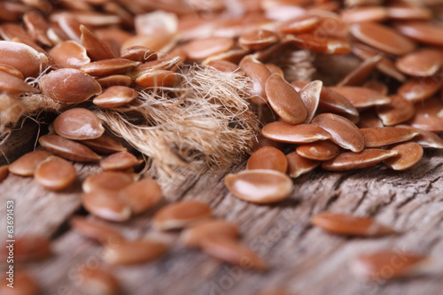 Flax seed scattered on burlap macro horizontal