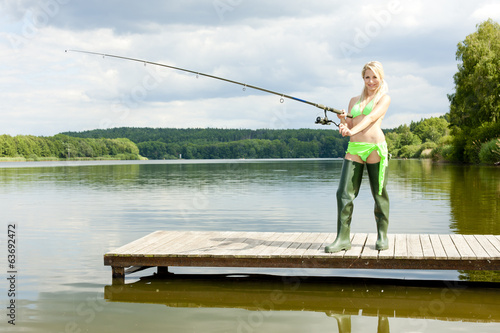 fishing woman standing on pier