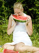 woman with melon at a picnic