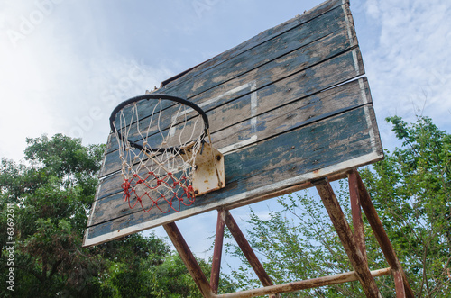 Old Basketball hoop on a blue sky.