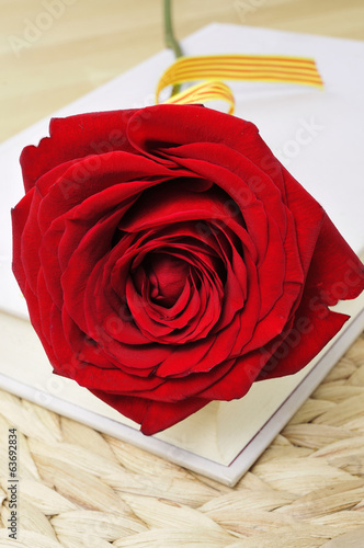 canvas print picture red rose and book, for Saint Georges Day in Catalonia, Spain