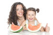 Happy mother and little girl with watermelon