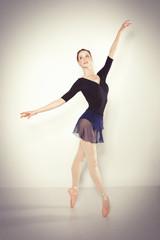 Young dancer posing in a studio