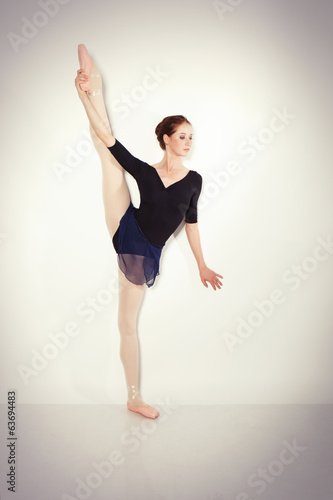 Young dancer posing in a studio