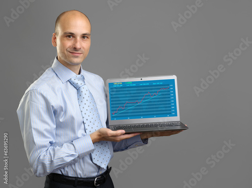 analyst presenting financial graph on a laptop screen