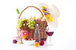 picnic basket with bottle of wine,fruits, bread and summer hat