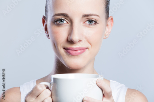 woman holding a coffee cup.
