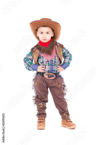 Little boy wearing cowboy suit