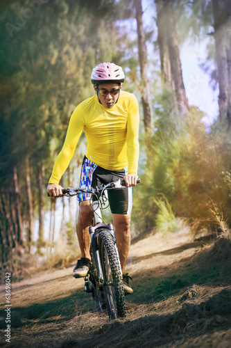 young man riding mountain bike mtb in jungle track use for sport