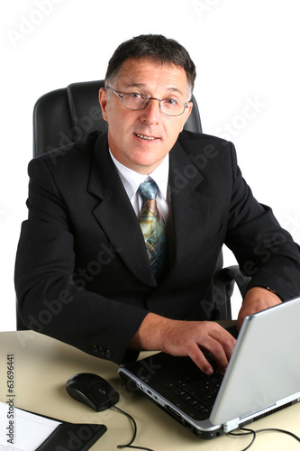 Portrait of businessman with computer