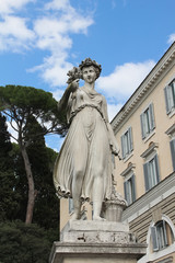 One of the four allegorical sculptures in Piazza del Popolo