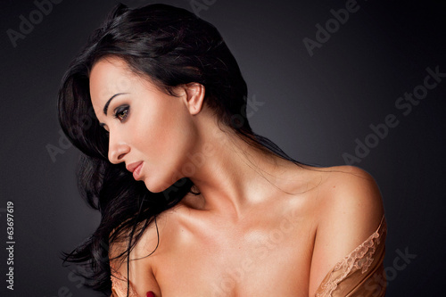 beautiful woman in robe with naked shoulder