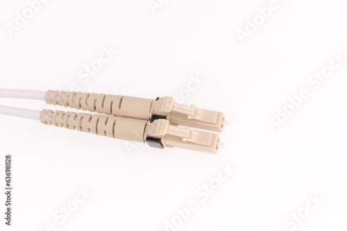 Fiber optic cables isolated on grey background
