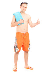 Man in swimsuit giving thumb up