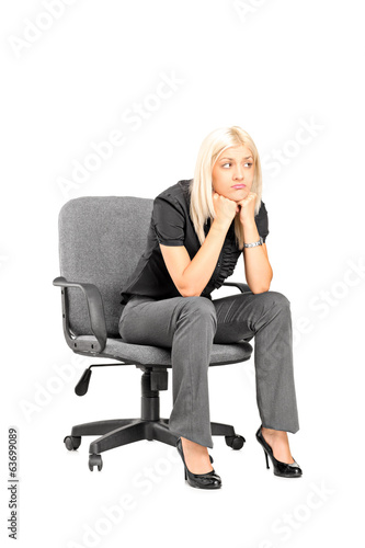 Sad woman sitting in a chair