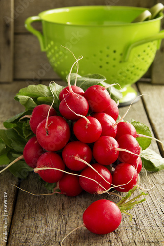 large bunch of fresh radish on dark boards