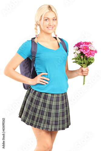 Schoolgirl holding a bouquet of flowers