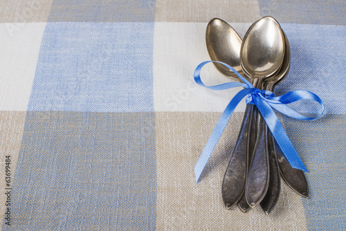 Vintage spoons closeup as background