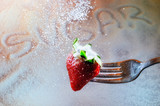 Strawberry on a fork punctured and sugar poster