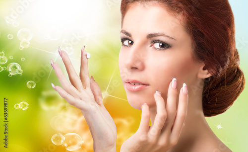 Beauty Girl Portrait. Beautiful Spa Woman Touching her Face