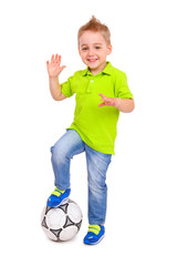 Happy little boy with a soccer ball